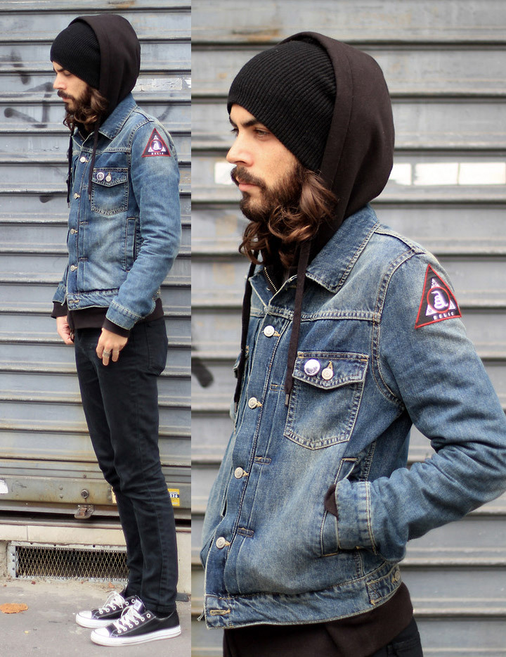 A collage of two pictures of a bearded man wearing a denim jacket styles with patches, and a black knitted hat as part of a winter outfit