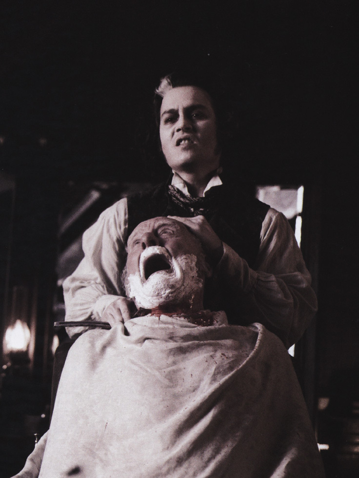 Still image from Victorian barber Sweeny Todd, of Jonny Depp slicing the throat of a customer