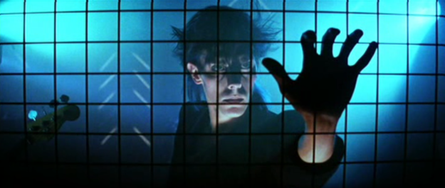 Still image of Peter Murphy in the opening scene of The Hunger