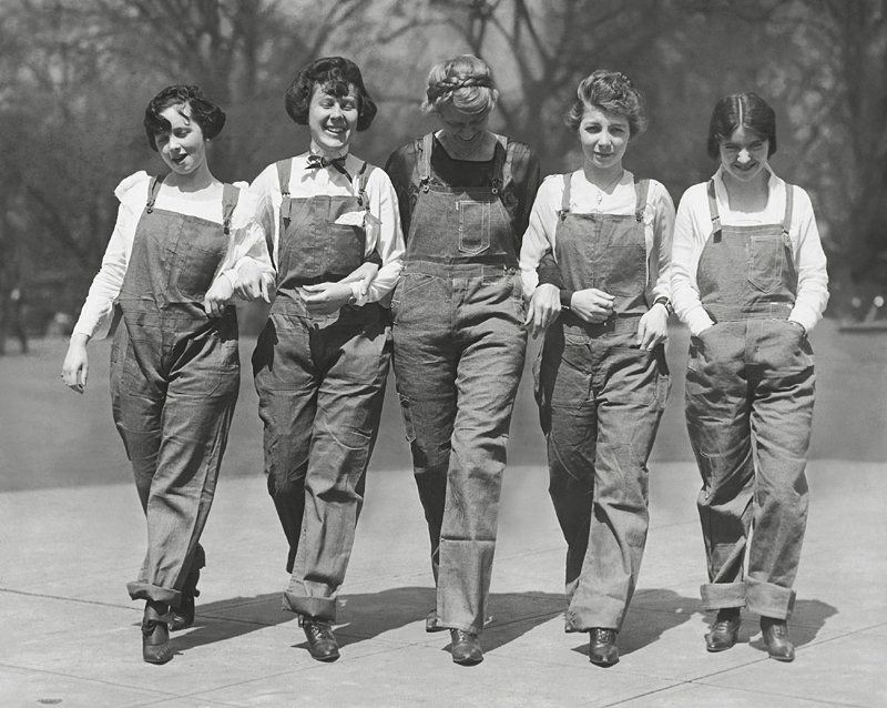 Historical image of women working in the 1920s, with their hands in their pockets