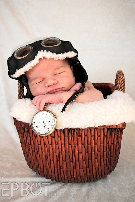 Steampunk baby time traveler, in a basket with steampunk goggles