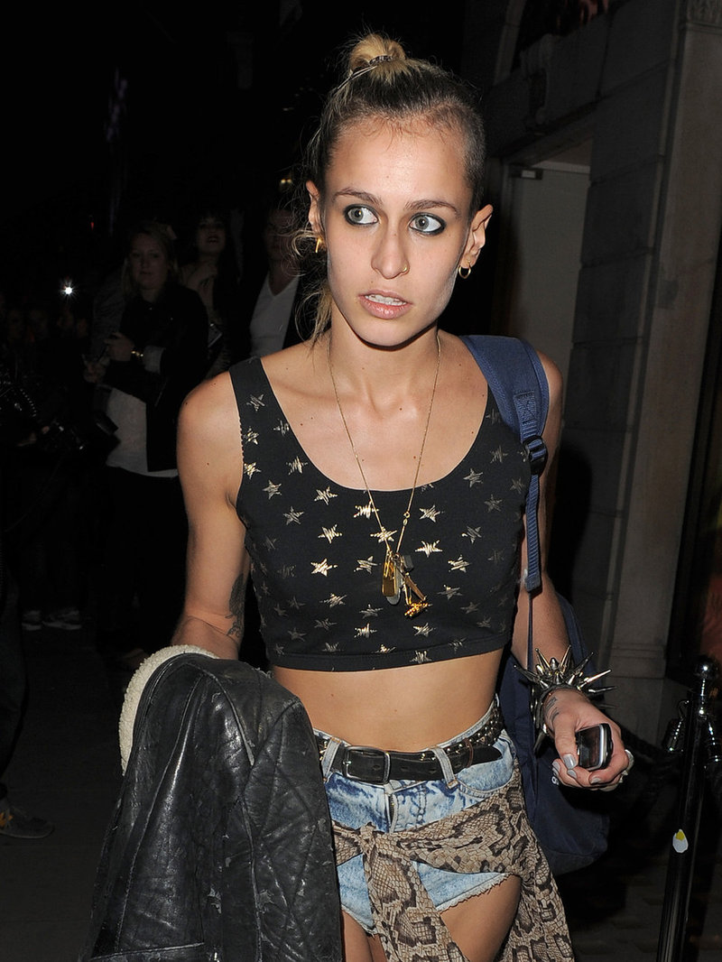 A cute grunge outfit on Alice Dellal, wearing a black crop top, hotpants and spiky punk bracelet