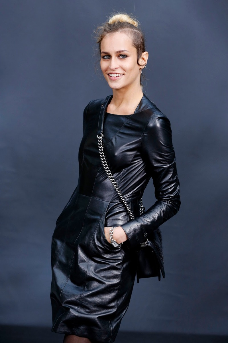 Alice Delal models the subtle punk look with a black leather dress and grungy makeup