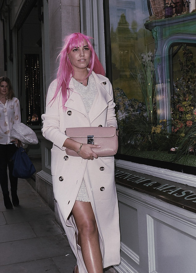 Amber Le Bon wears pastel pink and with pink hair
