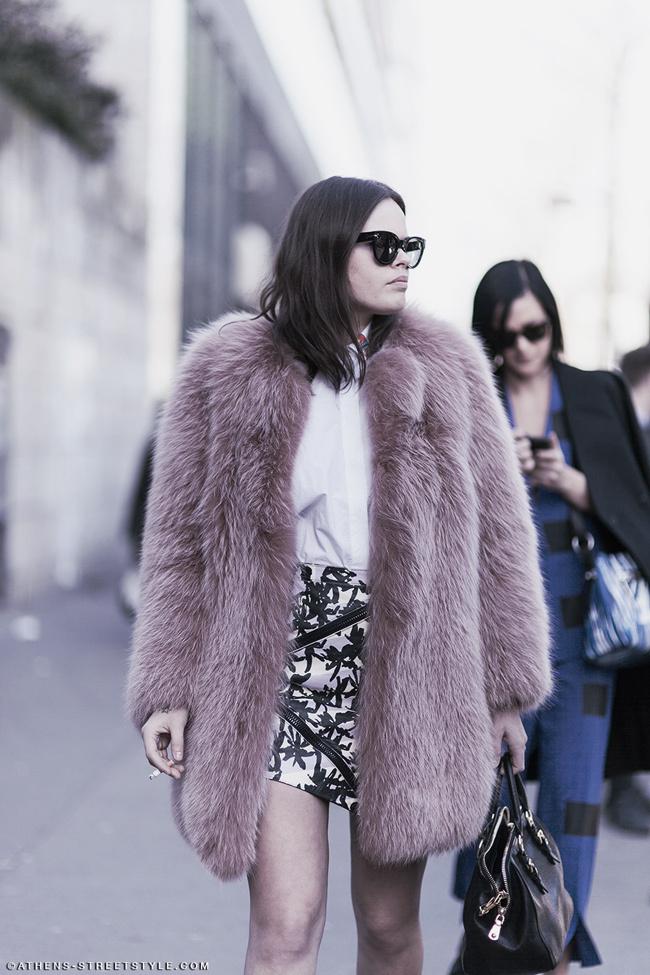 Atlanta de Cadenet wears a fur coat, oversize sunglasses and a printed skirt