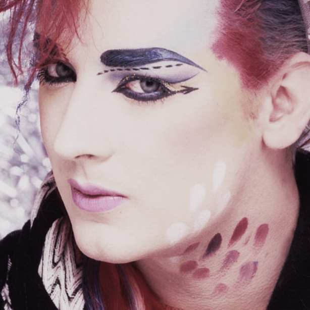 A Visual History of Cat Eye Makeup: Boy George wearing intricate eye makeup