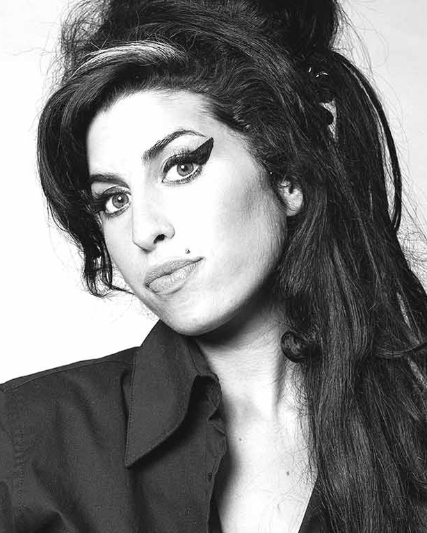 A Visual History of Cat Eye Makeup: Amy Winehouse always wore thick eyeliner