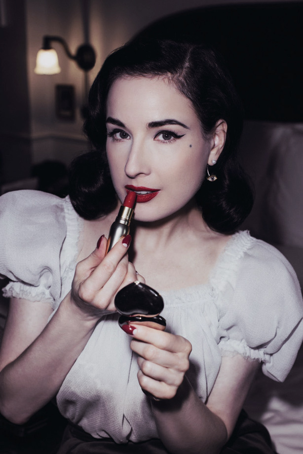 A Visual History of Cat Eye Makeup: Dita Von Teese wears a subtle but glamorous flick of eyeliner