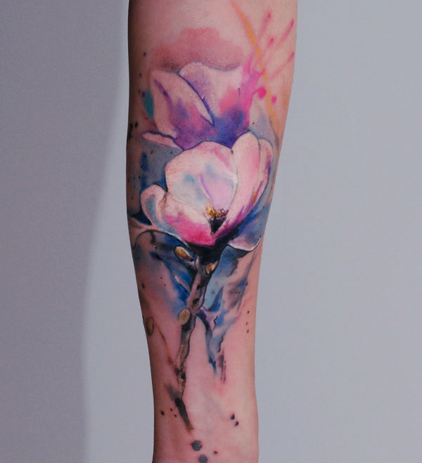 Watercolor Tattoos: A beautiful watercolor tattoo arm piece